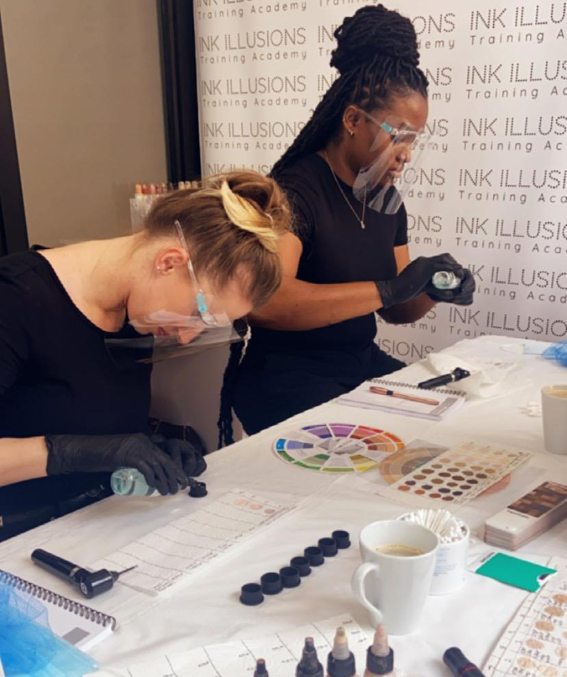 classroom photo of students learning colour theory for skin tone tattooing